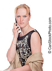 Woman with angry look talking on mobile phone isolated on white