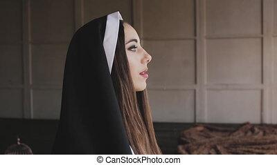 bad nun smoking a cigarette - bad nun blows smoke in church