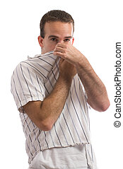 Bad Smell - A young man holding his nose because of a bad...