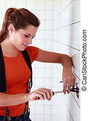 badkamer, elektromonteur, vrouwlijk, werkende