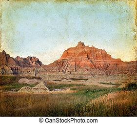 Badlands Mountains on a Grunge Background