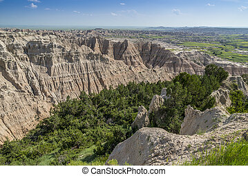 Badlands with green canyon