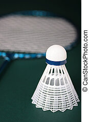 Badminton Equipment - A white synthetic shuttlecock and a ...
