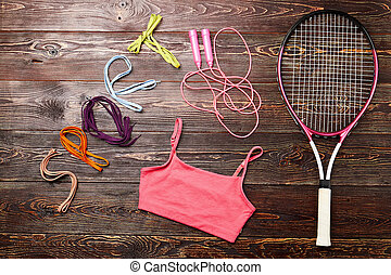 Badminton racket and skipping rope. Disclose your...