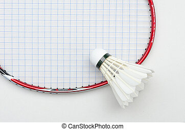 badminton racket in red color and light blue string with shuttlecock in top right partial view on white background