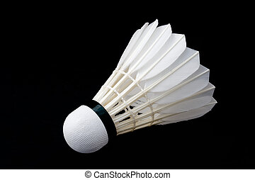 Badminton shuttlecock isolated against a black background