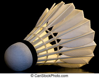 Badminton shuttlecock on the black background with ...