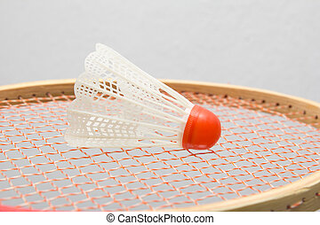 Badminton shuttlecocks with the racket