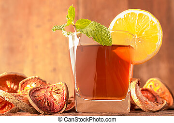 Bael fruit tea - A glass of Bael fruit tea with lemon slices...