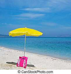 bag and umbrella at the beach