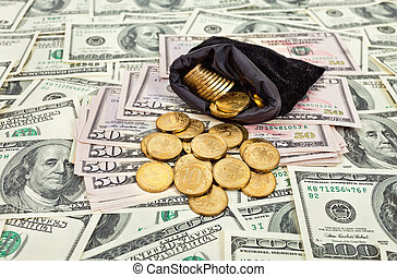 Bag filled with coins over US banknotes background