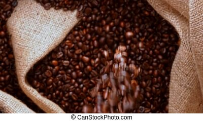 Bag filling with freshly roasted coffee.