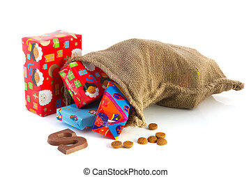 Jute bag full of Dutch Sinterklaas presents with colorful wrapping paper