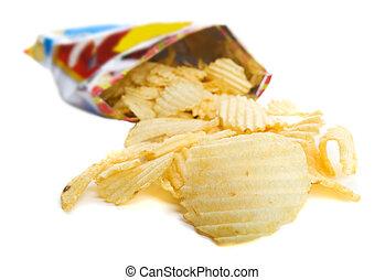 Bag of chips - Spilt bag of ripple chips on a white...