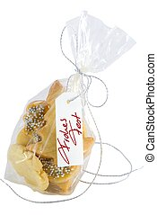 bag of christmas cookies with handwritten banner Frohes Fest