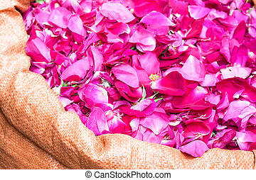 large bag with fresh pink edible rose petals