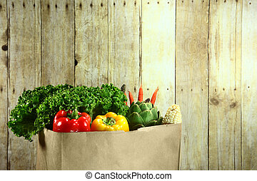 Bag of Grocery Produce Items on a Wooden Plank - Bagged...