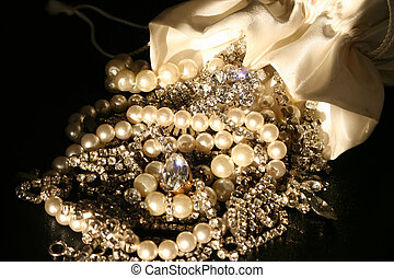 bag spilled over with jewels falling out
