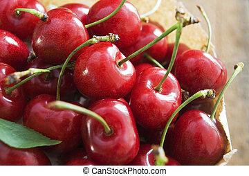 Bag Of Red Cherries - Paper bag full of red cherries on...