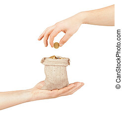 Bag with coins in hand isolated on white