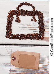 Bag with handle made of coffee beans and paper tag.