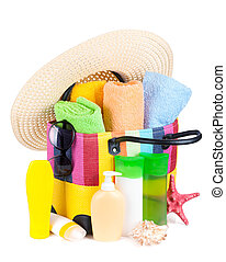 Bag with towels, sunglasses, hat and beach items