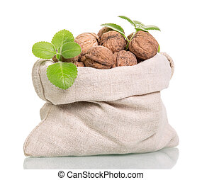 Bag with whole walnuts isolated on white.