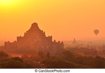 Bagan in sunrise - Dhammayangyi, largest temple in Bagan,...