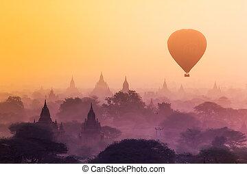 Bagan, Myanmar - Hot air balloon over misty morning around...