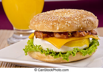 Bagel breakfast - Bagel with bacon, egg, cheese and orange...