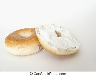 bagel cut in half with cream cheese shallow dof