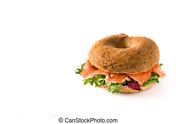Bagel sandwich with cream cheese, smoked salmon and vegetables isolated on white background.