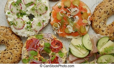 Bagel sandwiches with various toppings, salmon, cottage ...