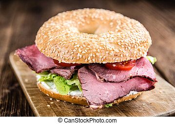 Bagel (with Roast Beef) on vintage background (selective...