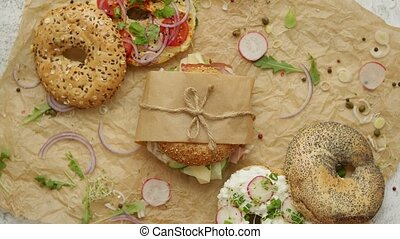 Bagels with ham, cream cheese, hummus, radish wrapped in ...