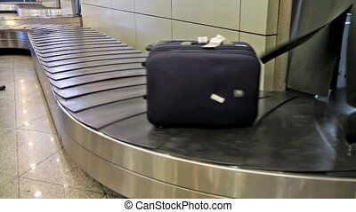 Baggage - baggage conveyer moves