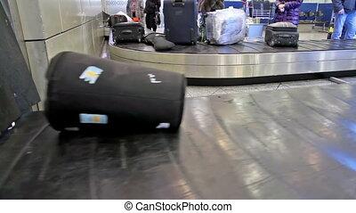 Baggage - baggage conveyer moves