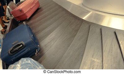 Baggage carousel in motion. Bags in the airport. Travel...
