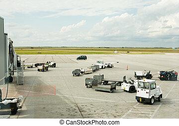 Baggage Cars - Baggage cars at an airport terminal.