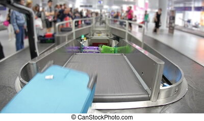 """baggage claim area of terminal, inside airport"""