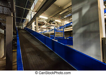 Baggage claim area with empty baggage carousels