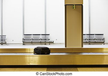 Baggage claim - Woman is waiting at the airport.
