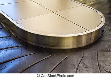 Baggage conveyor belt at the airport terminal