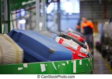 Baggage sorting - Baggage on conveyor belt at the airport - ...