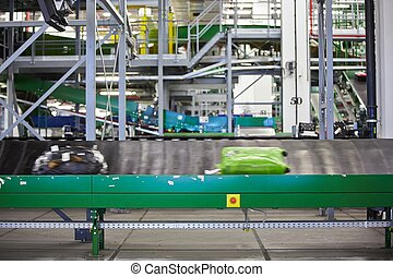 Baggage sorting - Baggage on conveyor belt at the airport -...