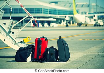 Baggage in front of the airplane