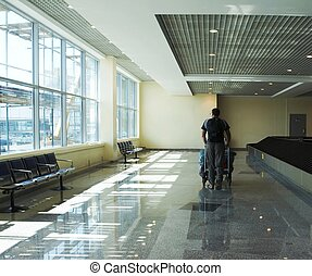 Baggage - Man traveler walking thru airport terminal
