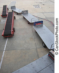 Baggage trolleys - Airport baggage handler's equipment.