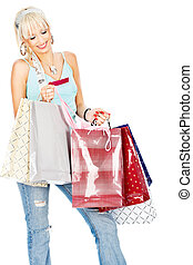 Bags and credit card in her hands