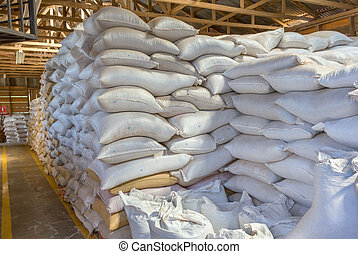 Bags in warehouse - Stack of white bags at warehouse